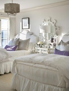 White! splash of purple & silver-ish pillows  Credit: Joy Tribout Interior Designs