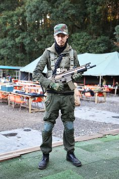 Airsoft Player in Japan. Fashion Photo.  NEW EAR cap. Military. Gun. Combat