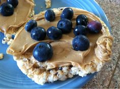 rice cake with pb and blueberries.  Would also be good with laughing cow or cream cheese.