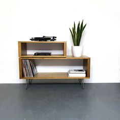 This design can normally be ready to ship in 2-3 days. Description: This is an offset double height storage cabinet designed as a media cabinet that can also be used to store vinyl records. It can also be used as a sideboard, console or bookshelf. Both sides are finished in the same