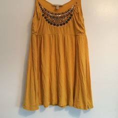 Top Dandelion colored, flowy, spaghetti strap top. Beading on the top with no beads missing. Perfect to wear with a pair of jeans! Lightly worn. Great color for your fall wardrobe  American Rag Tops