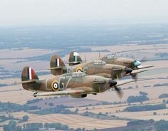 These British Royal Air Force Hawker Hurricane fighters fly in formation near London. A special commemoration of the role of 'Churchill's Few' was staged from the historic former RAF airfield, Biggin Hill. Biggin Hill Airport via epa Ww2 Aircraft, Fighter Aircraft, Military Aircraft, Fighter Jets, Drones, Photo Avion, Hawker Hurricane, The Spitfires, Supermarine Spitfire