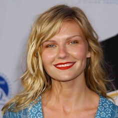 kirsten dunst messy wavy hair and bold red lips