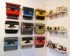 Typewriter collection display, I've never seen them displayed vertically and I'm loving it! Also digging the clock collection on the right.