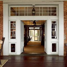 """Pinner wrote: Our entry way is very similar in that we have 3 sets of doors that open all the way through starting on our front porch all the way to our back porch.  I LOVE IT!!!  The house Mikey and I build will have the """"Old Southern"""" style/layout.  Andi has told me about the old southern homes with the central gallery that allows wind to blow through the house.  I like the idea"""