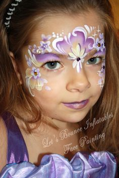 Fairy Mask Girls Face Painting by Let's Bounce Inflatables, Vancouver Face Painters. www.letsbounceinflatables.ca