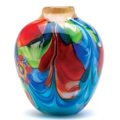 This jug-shaped art glass vase is a treasure of glowing color and graceful garden imagery. This stunning piece is individually hand-crafted for its unique beaut