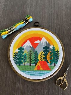 "Stitched version of ""Camping at the mountains"" cross stitch pattern by Axebe"
