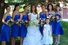 Let the bridesmaids choose their own style of dress in the same fabric/color.