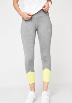 PUMA Spark Logo Tights let'z get physical babe! These figure hugging tights have contrasting neon colorblock details at the bottom with the logo on each leg and a lil inside stash pocket on the waist.