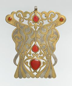 Turkoman pectoral ornament. Silver, fire-gilded and chased, with openwork and table-cut and slightly domed and cabochon carnelians. late 19th - early 20th Century. The Metropolitan Museum of Art.