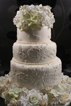Sugar lace cake with sugar flowers in pale green, white and cream, by Elizabeth's Cake Emporium. Love the butterflies!