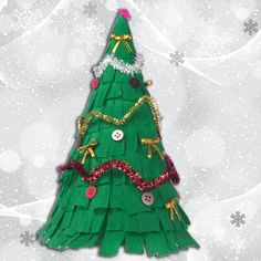 Te enseñamos a hacer, paso a paso, y de manera muy sencilla este árbol de Navidad con flecos, ¡a tus hijos les encantará! http://www.guiainfantil.com/articulos/ocio/manualidades/arbol-de-navidad-de-papel-manualidades-faciles/