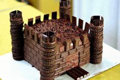 castle cake. add some hershey minature candy bars, kit kat for draw bridge. cookies for towers add icing inbetween and done