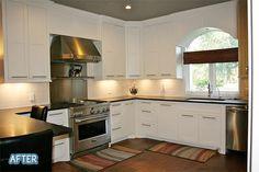 white cabinets, black countertops, wood floors
