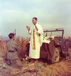 U.S. Army chaplain Father Emil Joseph Kapaun, who died May 23, 1951, in a North Korean prisoner of war camp, is pictured celebrating Mass from the hood of a jeep Oct. 7, 1950, in South Korea. He was captured about a month later. The Medal of Honor, the nation's highest military award for bravery, was awarded to the priest posthumously at the White House April 11, 2013. (CNS photo/courtesy U.S. Army medic Raymond Skeehan)