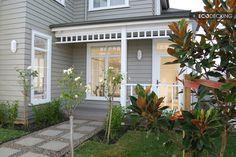 Grey house with white trim, nice path