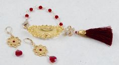 Russian Gold Plate bracelet bar, Swarovski Siam crystals, burgundy silk tassel, gold flowers, red crystal drops, 14kt gold-filled hooks. by ChrisAllenJewelry on Etsy