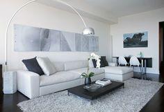 Splashy grey shag rug in Living Room Modern with Dark Floor White Wall next to Rug On Dark Floor alongside Loft Apartment and Art Above Sofa