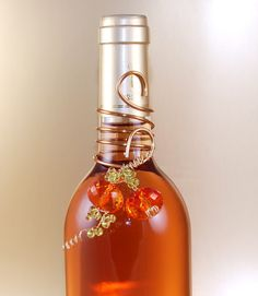 Wedding Party Favor Wine Bottle Decoration Festive Decor Beaded In Orange And Green - FALL Or AUTUMN Tones For The Reception via Etsy.