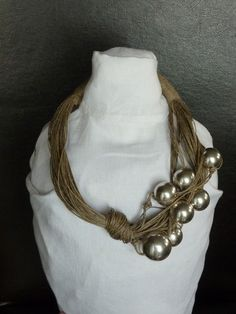 This unique necklace is made of linen thread and silver acrylic beads. The beads measrue 3cm and 24cm. I would like to show here that even linen can