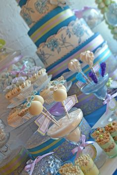 This French pastry themed dessert table was created around a bespoke wedding cake in white and cerulean blue with trim in pale green and lavender. Sweet Dessert Company.