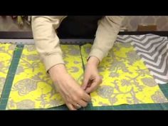 "Kris from ""My Girlfriend's Quilt Shoppe"" demonstrates how fast and easy it is to sew an envelope-style pillow. She is using ""chevron"" style of fabric. This makes a great pillow for your porch, a bench, couch, or bed."