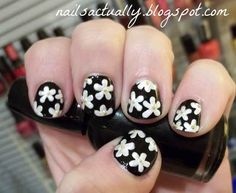 Goes perfectly with those daisy platform flip-flops you just ordered from the Delia's catalog. | 13 Bitchin' '90s-Inspired Nail Art Designs