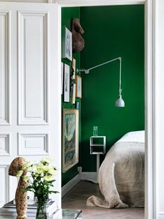 Green bedroom via the blog My Scandinavian Home.