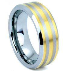 8mm yellow gold and silver tungsten carbide wedding band. This rings makes the perfect mens wedding band! See more here: https://northernroyal.com/collections/tungsten-carbide-rings/products/8mm-mens-tungsten-ring-with-yellow-gold-stripes