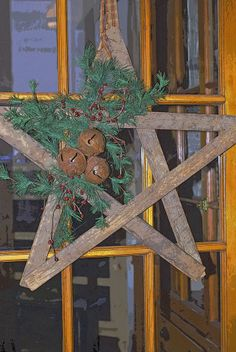 Large wooden star with rusty bells...