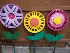 Repurposed hub caps into garden art flowers - my granddaughter helped =)