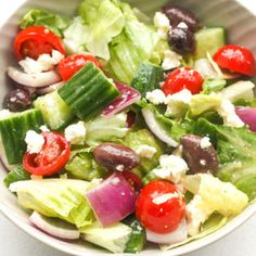 The Perfect Greek Salad: Juicy tomatoes, fresh cucumbers, crisp red onions, romaine lettuce, savoury olives and crumbled feta cheese drizzled with a lemon vinaigrette | aheadofthyme.com