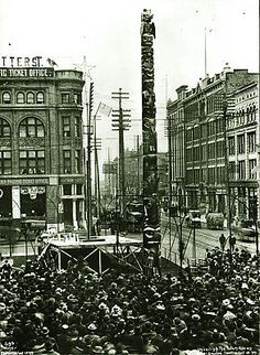 """Tlingit totem pole unveiled at Pioneer Square.  October 18, 1899.  The totem pole had been stolen from a Tlingit village in Fort Tongass, Alaska, a few days before.      The totem belonged to the Raven Clan (Kinninook) and had been carved ~1790 to honor a woman who had drowned.      A group of """"leading Seattle citizens"""" sent to Alaska by the Seattle P-I on a goodwill mission, chopped the totem pole and spirited it away while the tribe was out fishing.      An arsonist destroyed the pole in…"""