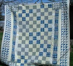 Great quilt made from shirts purchased at thrift shop -- notice half square triangle border!