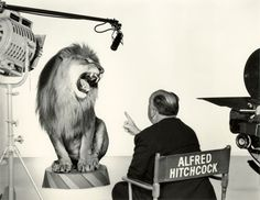 Alfred Hitchcock directs the MGM lion.