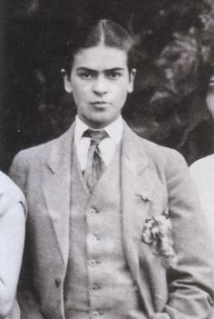 Detail of Frida posing in men's attire for a family portrait, taken by her father Guillermo Kahlo, 1926