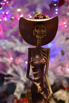 Fancy skeleton woman with designer hat, Day of Dead, dia de los muertos, Catrina doll from Puerto Vallarta, Mexico  by RYANISLAND, via Flickr