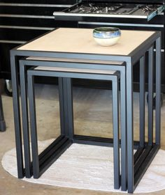 Handcrafted custom metal framed nesting tables with stained wood top