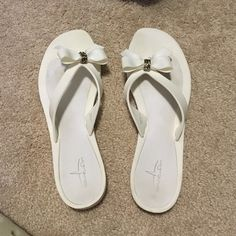 White bow sandals These white bow sandals have only been worn once. They are perfect for the beach or to wear with a casual outfit to make it more girly Shoes Sandals