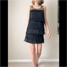 MNG fringe two piece dress with top and skirt MNG suit edition. Fringe two piece dress you can wear just the top or wear it with the skirt to have the fringe dress look. Only wore it once! The production of this suit edition runs small. Good as new. MNG Dresses Mini