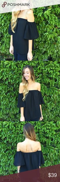flowy off the shoulder top offers welcome black off the shoulder top with flowy sleeves and smooth material. modeling size small. •461108• Tops Blouses