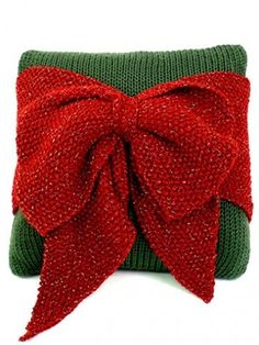 Yarnspirations.com - Caron Christmas Bow Pillow - Patterns  | Yarnspirations   This is knit, but could easily be crocheted.