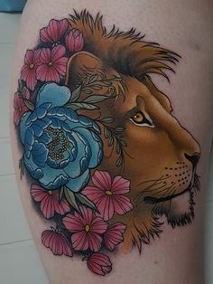 Lion Head Tattoo with Flowers for Women by CT Tattoo Artist Cracker Joe Swider.