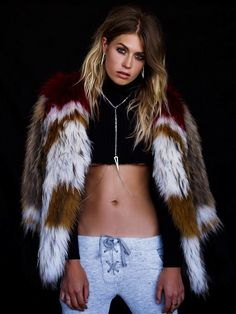 Furry coat layered over a crop top and body chain for Luv AJ's Holiday Collection Lookbook // Photo by Chris Shintani