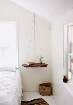 suspended end table. i would use old growth redwood or petrified wood. want in our loft.
