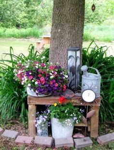 How to create a Flea Market garden vignette  An old wooden bench set against a tree is the stage for cuteness!