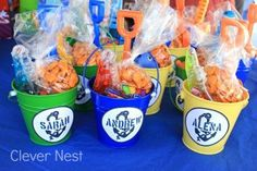 Nautical themed party favors in metal pails. Get the printable label here: http://www.myclevernest.com/2012/09/andrews-first-birthday-vintage-nautical.html