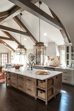 kitchen with timber framed vaulted ceilings and amazing island
