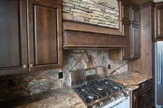 I love how the veins in this stone counter top look like tree branches.Rustic Kitchen - Found on Zillow Digs. What do you think?